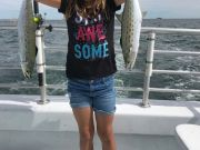 Crystal Dawn Head Boat Fishing and Sunset Cruise, Young Manteo angler shows off her double header Spanish mackerel!
